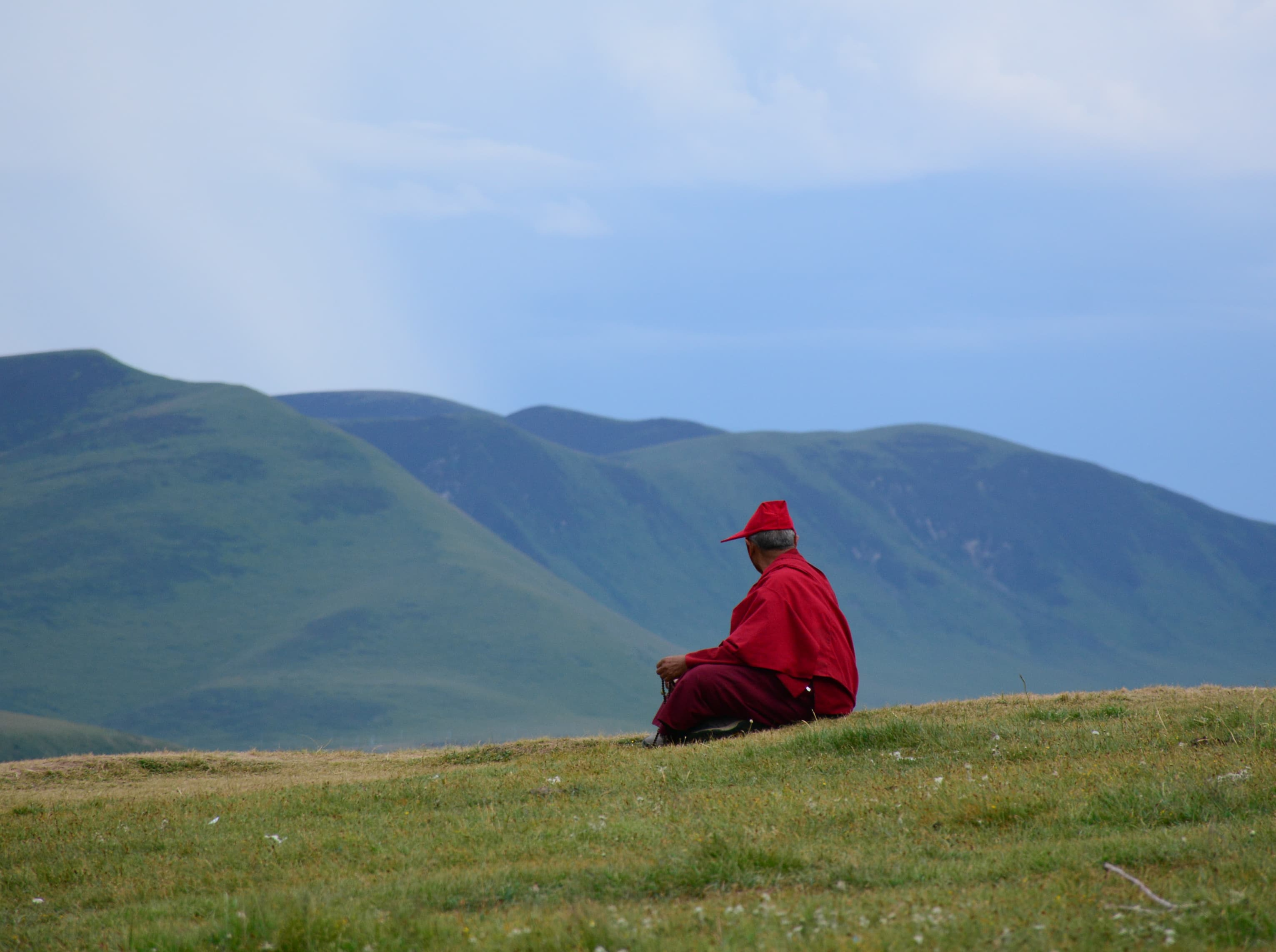 Tibetan monk meditating outside